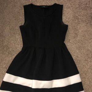 Black dress with white stripes